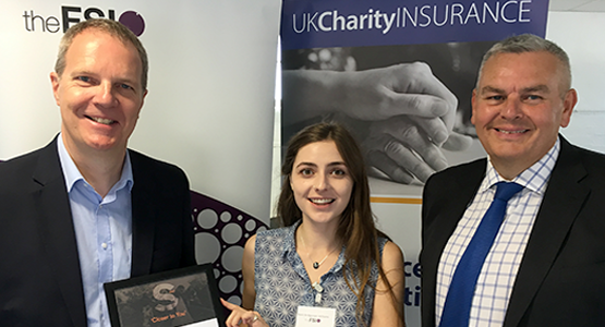 Neil Franklin of UK Charity Insurance (left) presents the grant to Remi Bridgeman-Williams of the FSI (centre) with David Christy of Ecclesiastical (right)